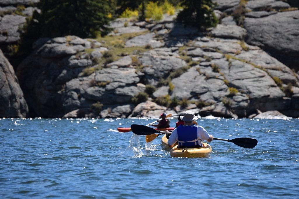 People kayaking in the ocean.